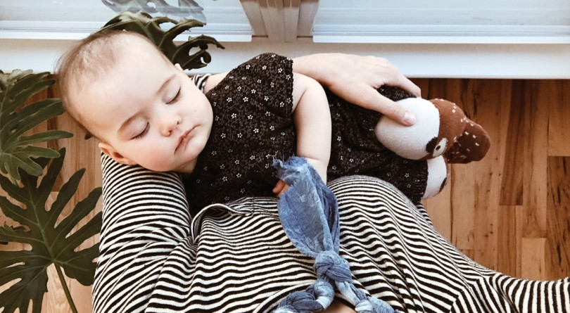 Woman holding a sleeping baby