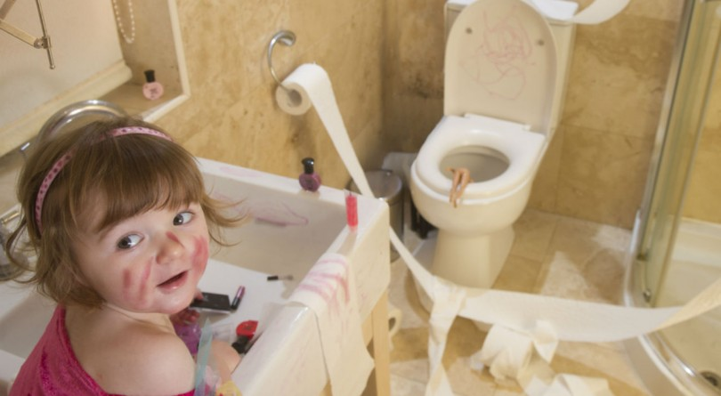Toddler making a mess in the bathroom