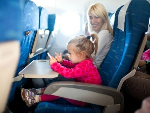 child and mother on an airplane