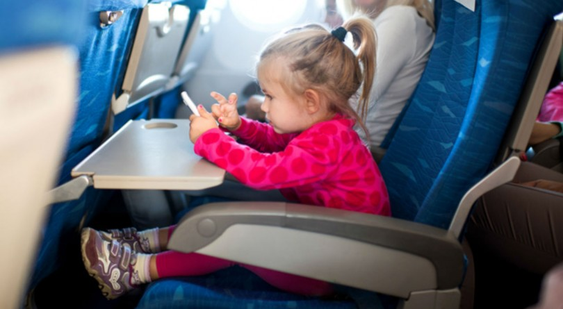 Toddler on an airplane with mom