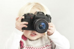 Baby holding a camera