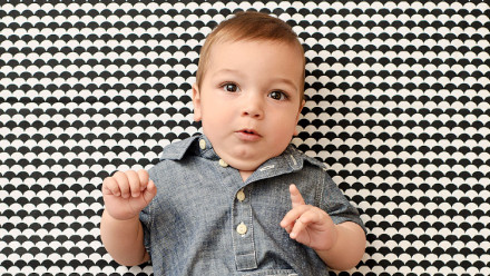 cute 8 month old baby point ing one finger to the camera