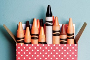 crayon box full of skin tone colours and the black crayon sticking out