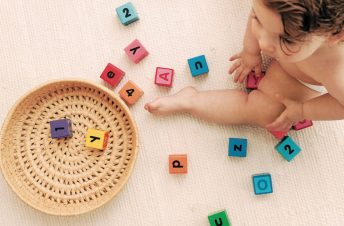 Toddler surrounded by blocks