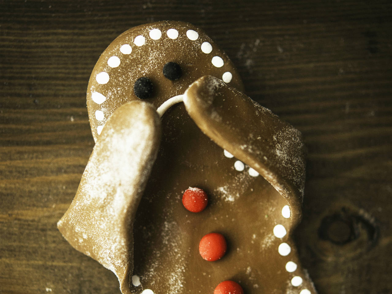A gingerbread cookie looking sad