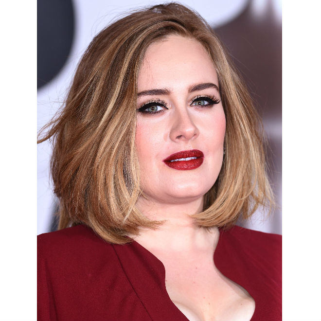 Photo of Adele in a red dress