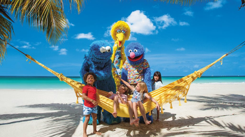 Kids with Sesame Street on the beach