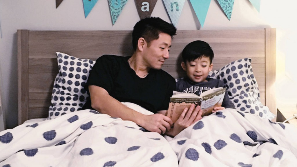 A bad reading to his son in bed