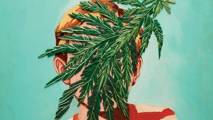 Painting of kid with leaves embroidered over his face