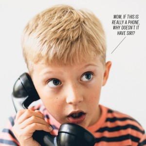 kid holding an old phone receiver up to his ear with a speech bubble that reads, Mom if this is really a phone, why doesn't it have siri?