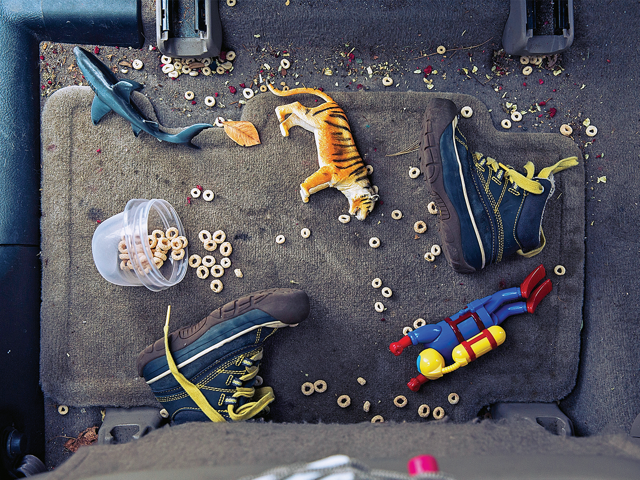 Messy floor of every parents' car