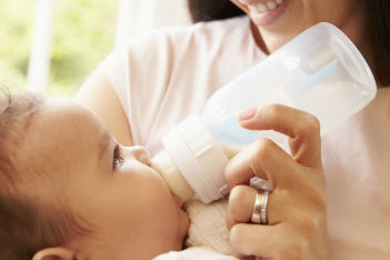 How to safely warm a bottle of breast milk or formula