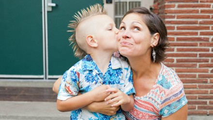 A little boy kissing a woman on the cheek