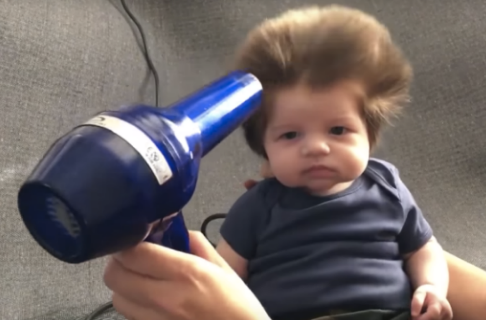 7 cute babies with lots of hair