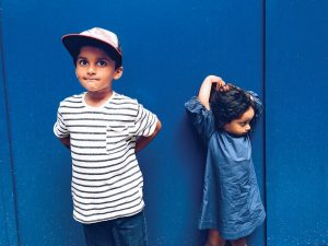 Two kids on a blue background