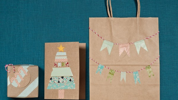 Three presents wrapped in brown paper with washi tape