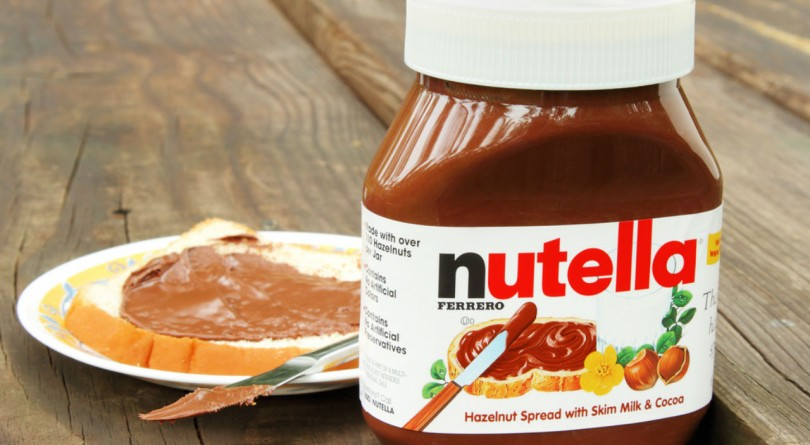 Bottle of nutella with toast