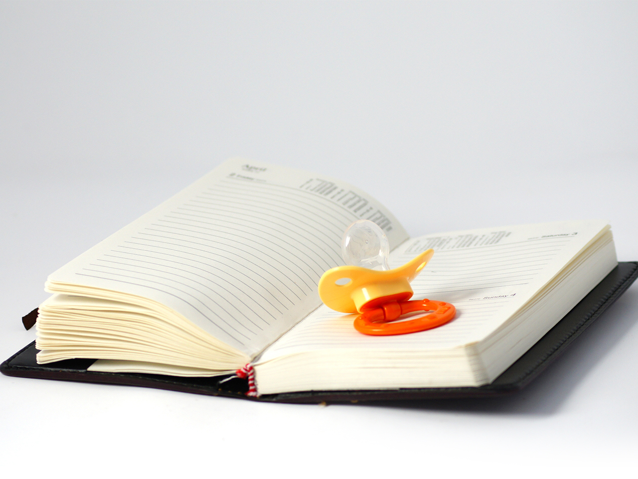 Pacifier on an open book