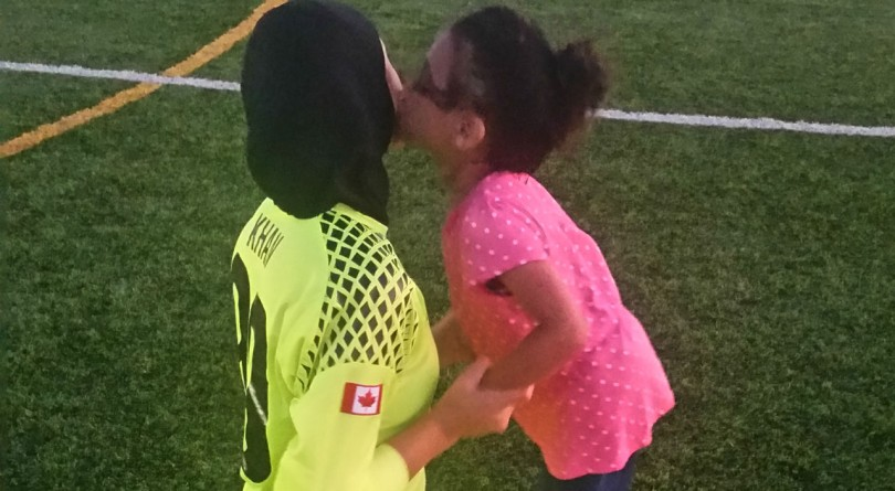 The author's daughter in uniform on the soccer field with her cousin
