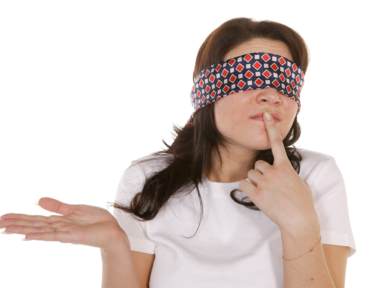 Woman wearing a blindfold holds out her hand