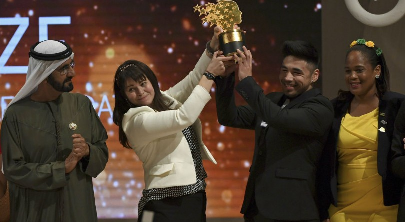 Maggie MacDonnell receiving prize in Dubai at the Global Teacher Prize ceremony
