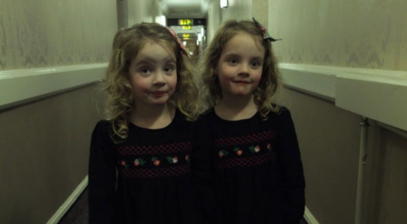 Dad's girls posed as The Shining twins in a hotel hallway