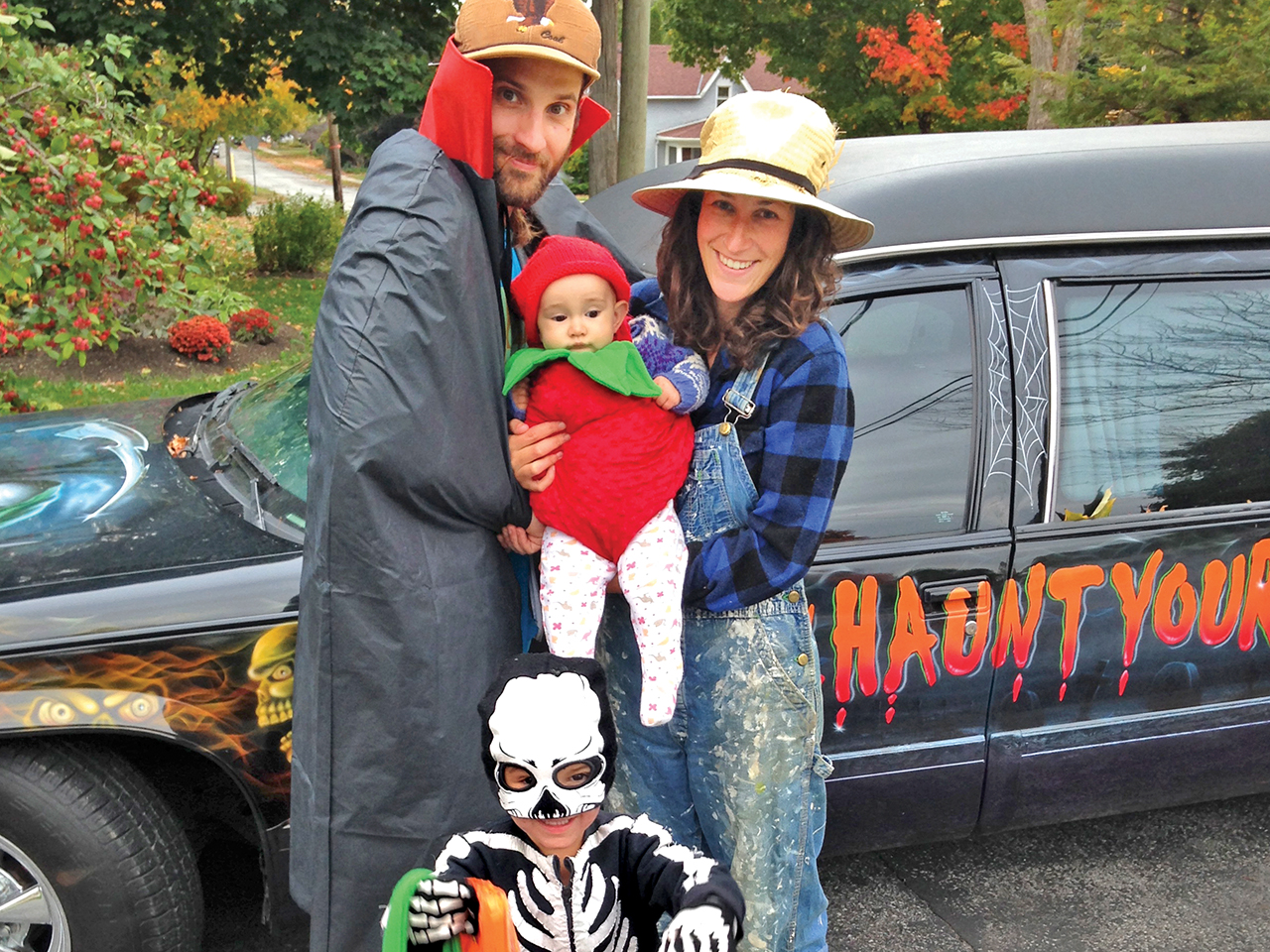 Family dressed up to go trick-or-treating for halloween