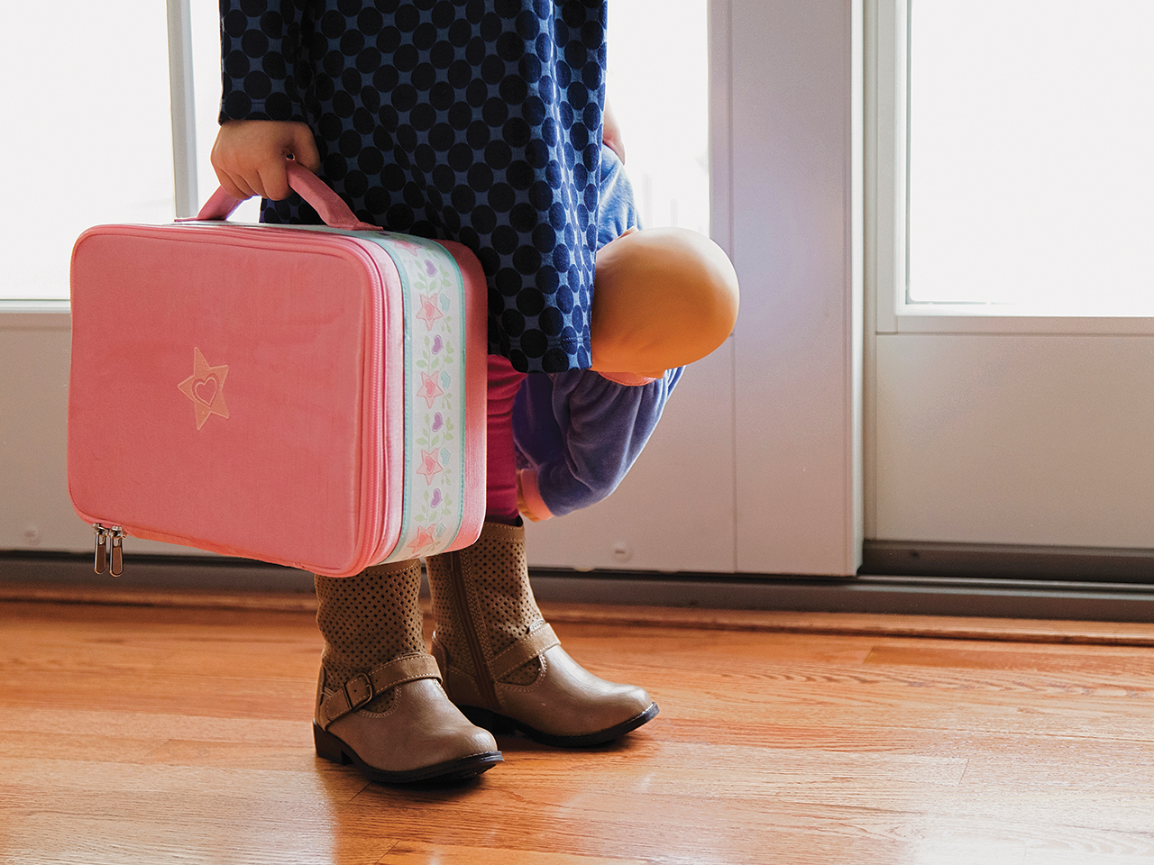 Little girl with suitcase running away from home