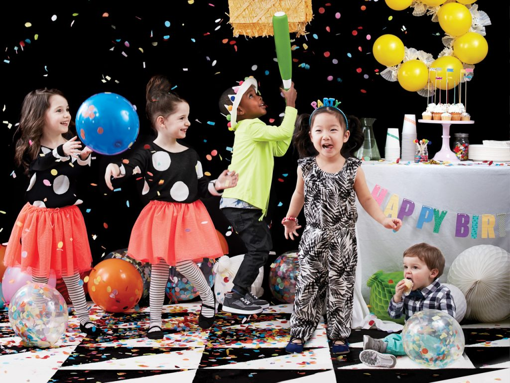 group of kids having fun at a birthday a party
