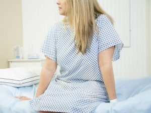 A woman in a hospital gown