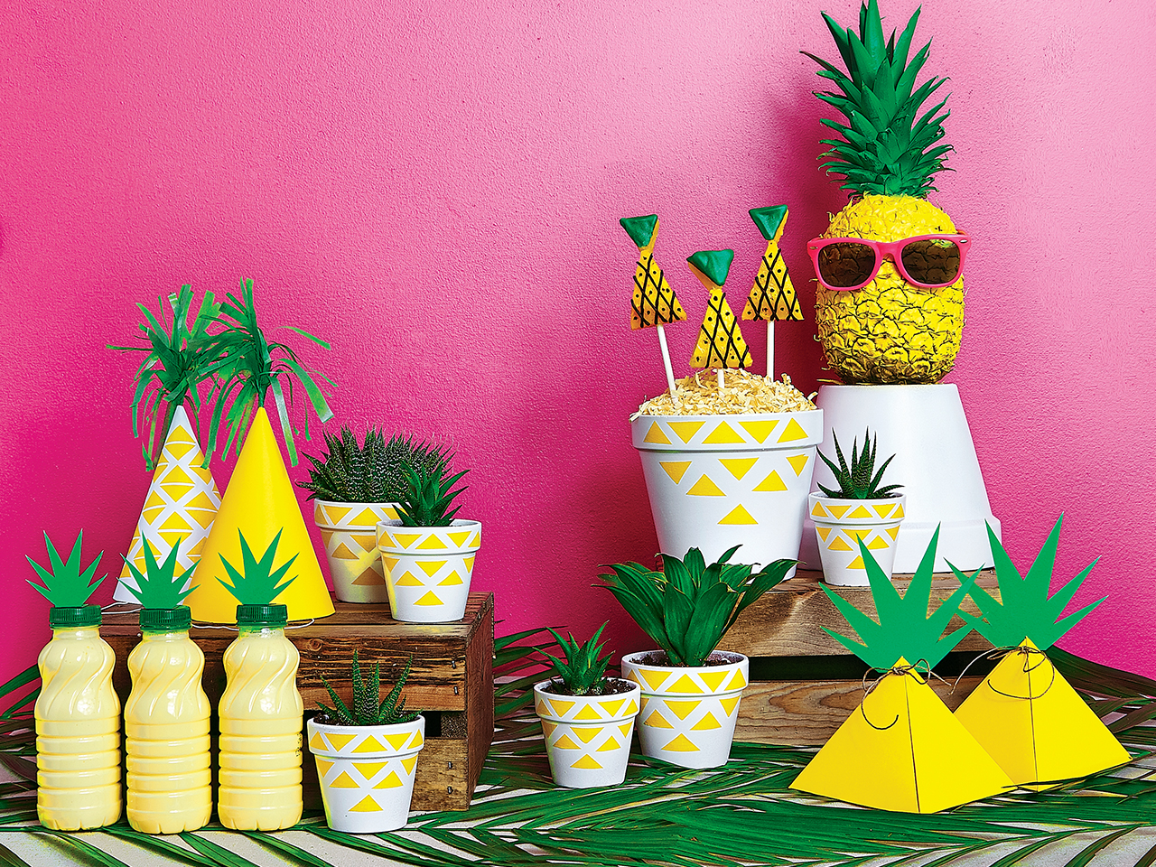 A table spread for a pineapple party