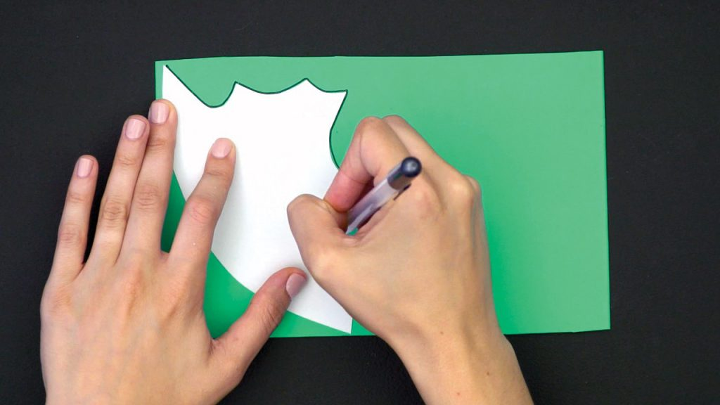 hand tracing on green construction paper