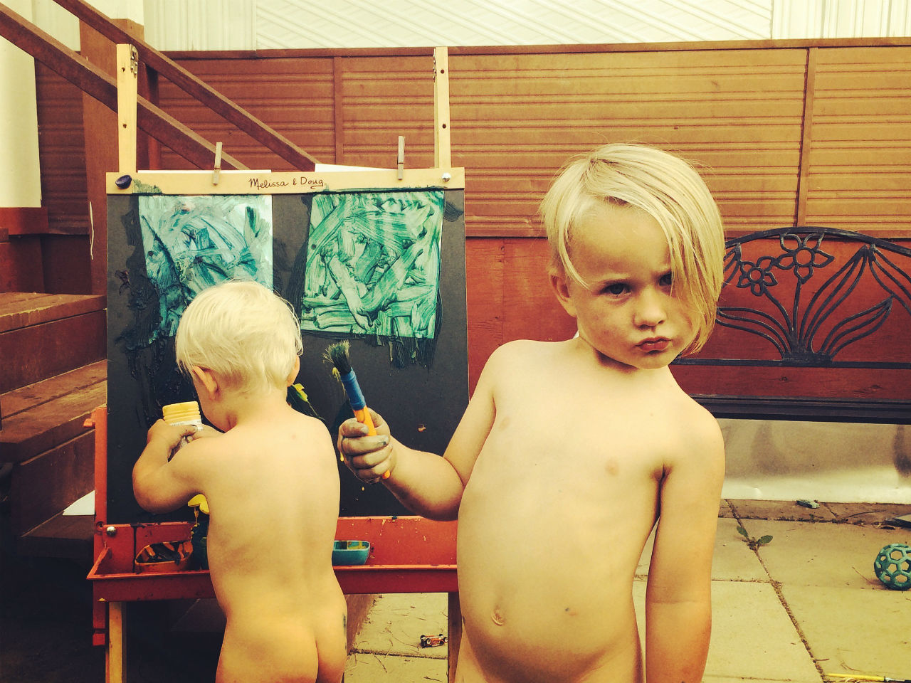 Two brothers playing around in the nude
