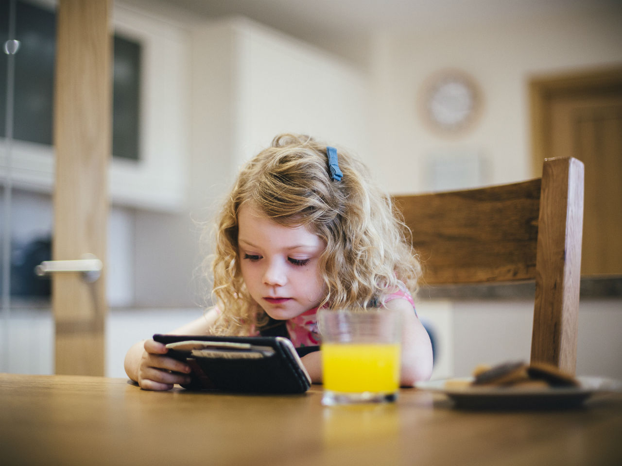 Little girl looking at an iPad