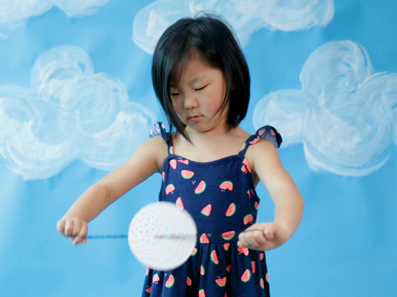 girl playing with fidget toy
