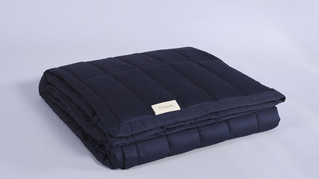 navy weighted blanket folded up
