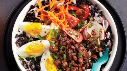 rice bowl with ground beef, hardboiled eggs and shredded veggies