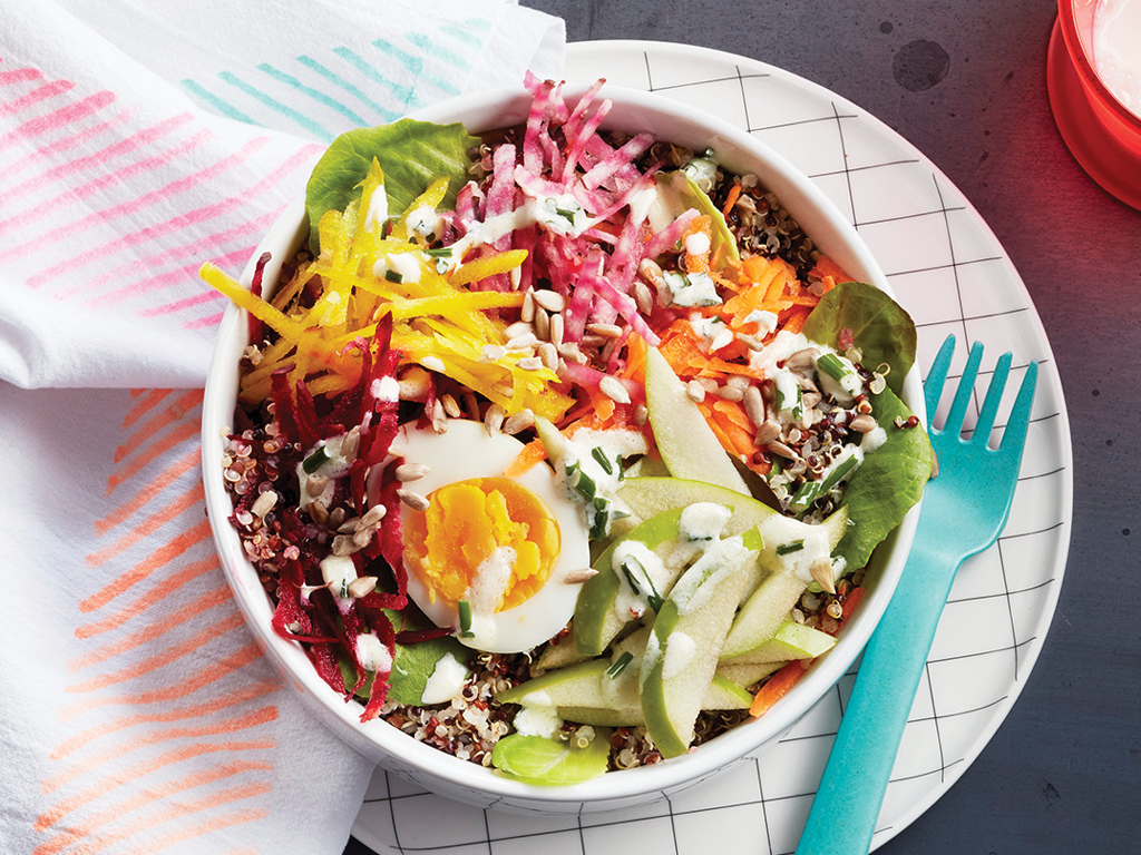 quinoa bowl with grated veggies, hardboiled egg and dressing