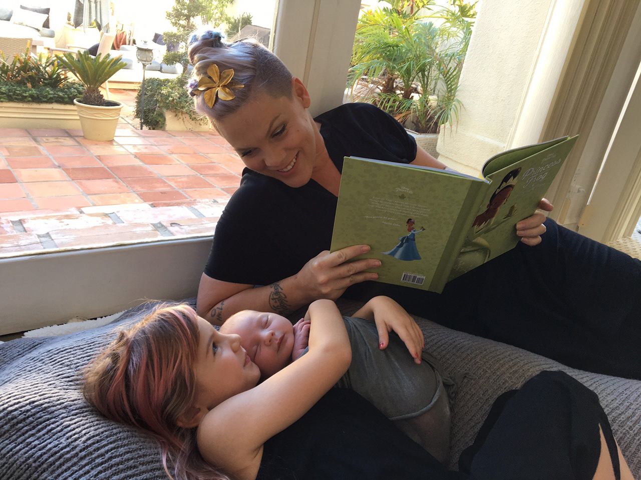 Pink reading to her kids