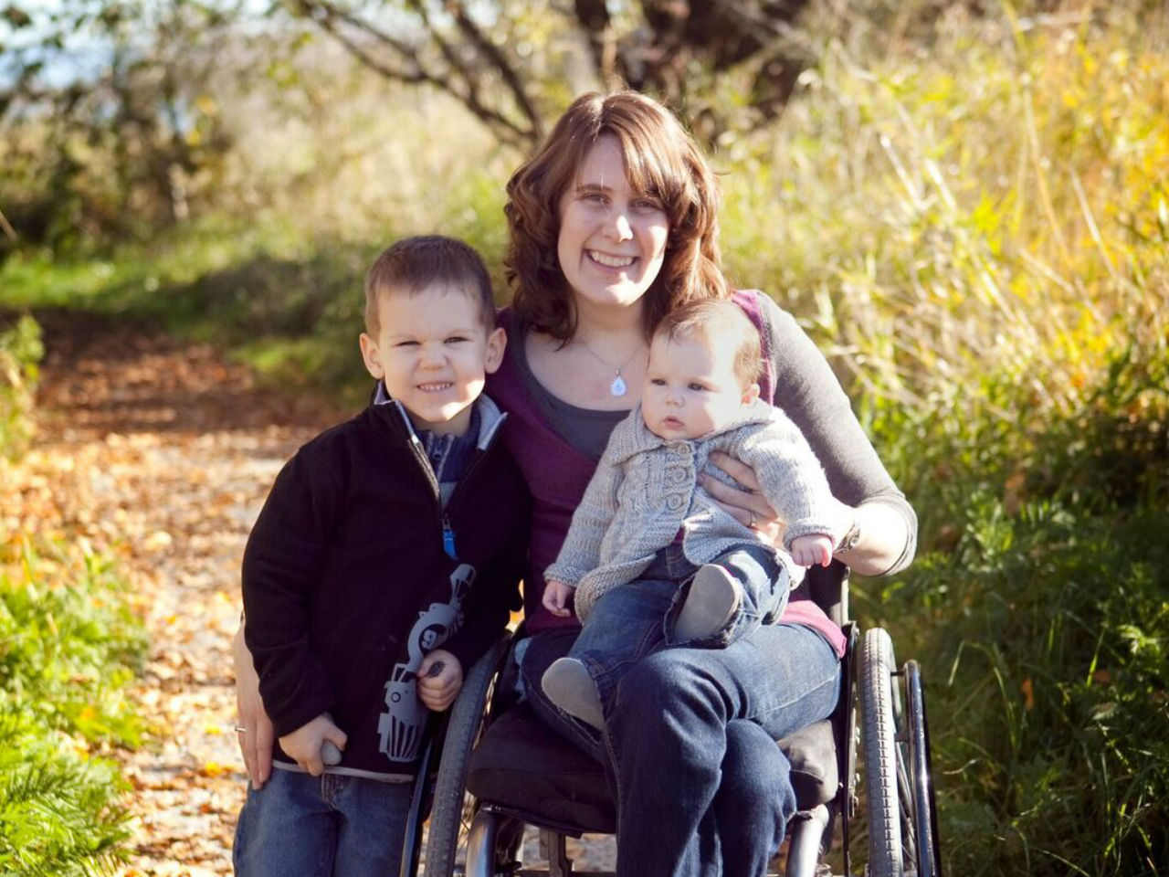 mother in wheelchair with her two children