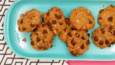 A plate of cookies with chocolate chips in them