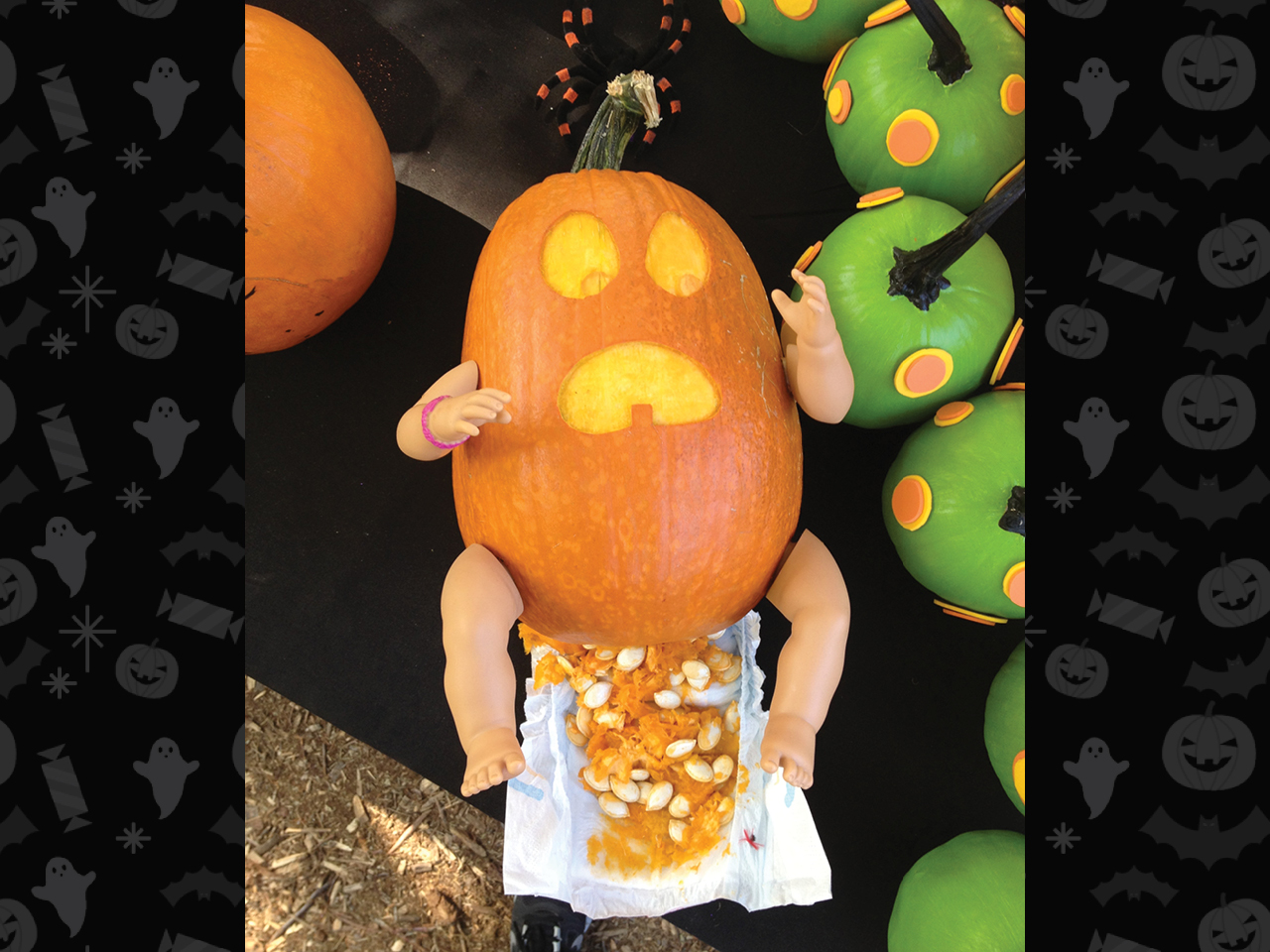 pumpkin carved as baby with a full diaper