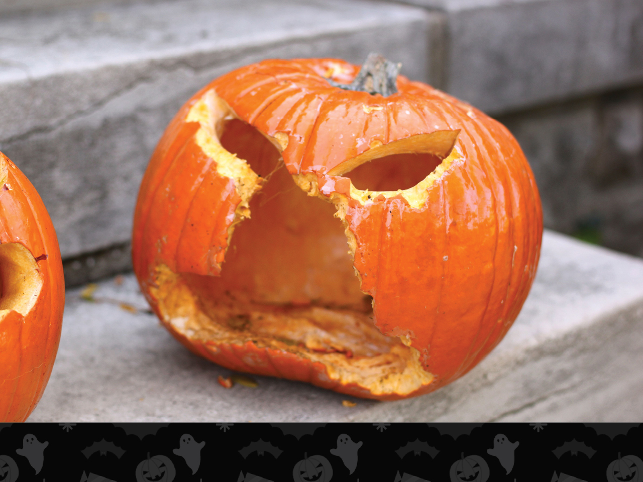 jack o' lantern with face eaten away by squirrels