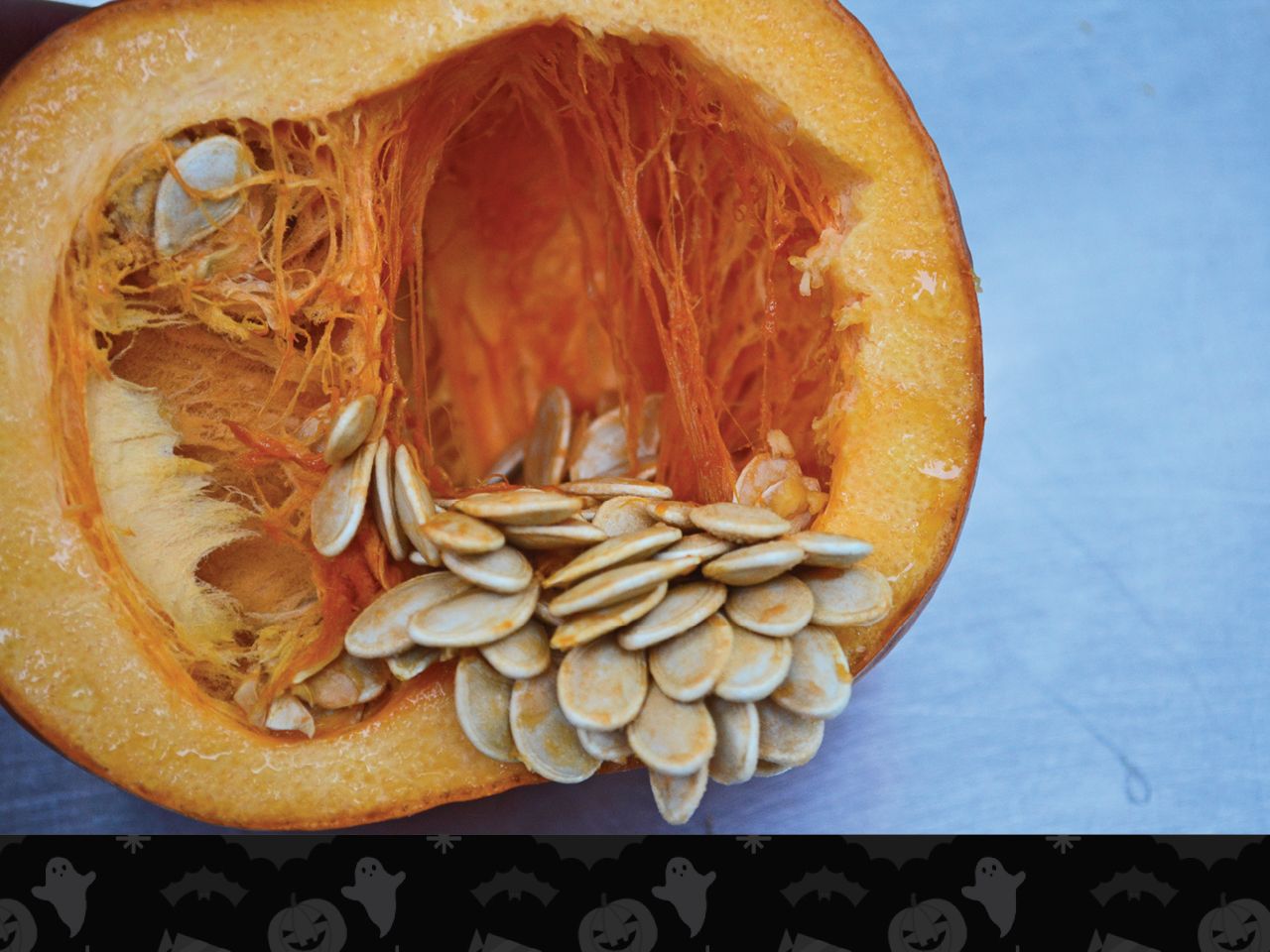 pumpkin cut open showing seeds and guts