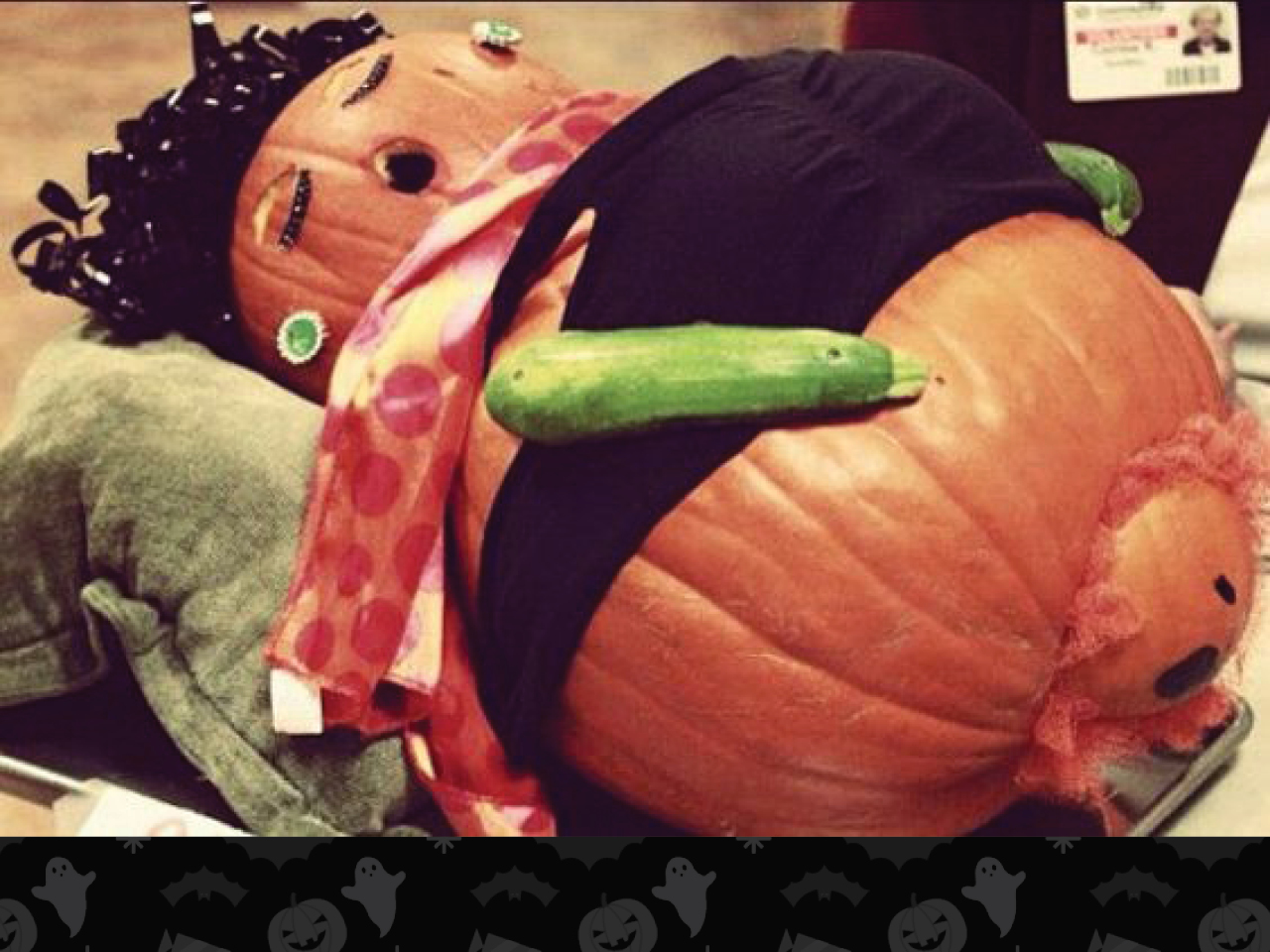 pumpkin carved as pregnant woman with zucchini arms and giving birth