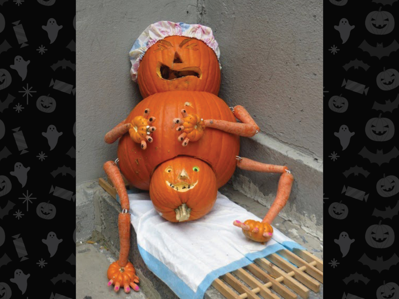 pumpkin carved as pregnant woman wearing a bathing cap and giving birth