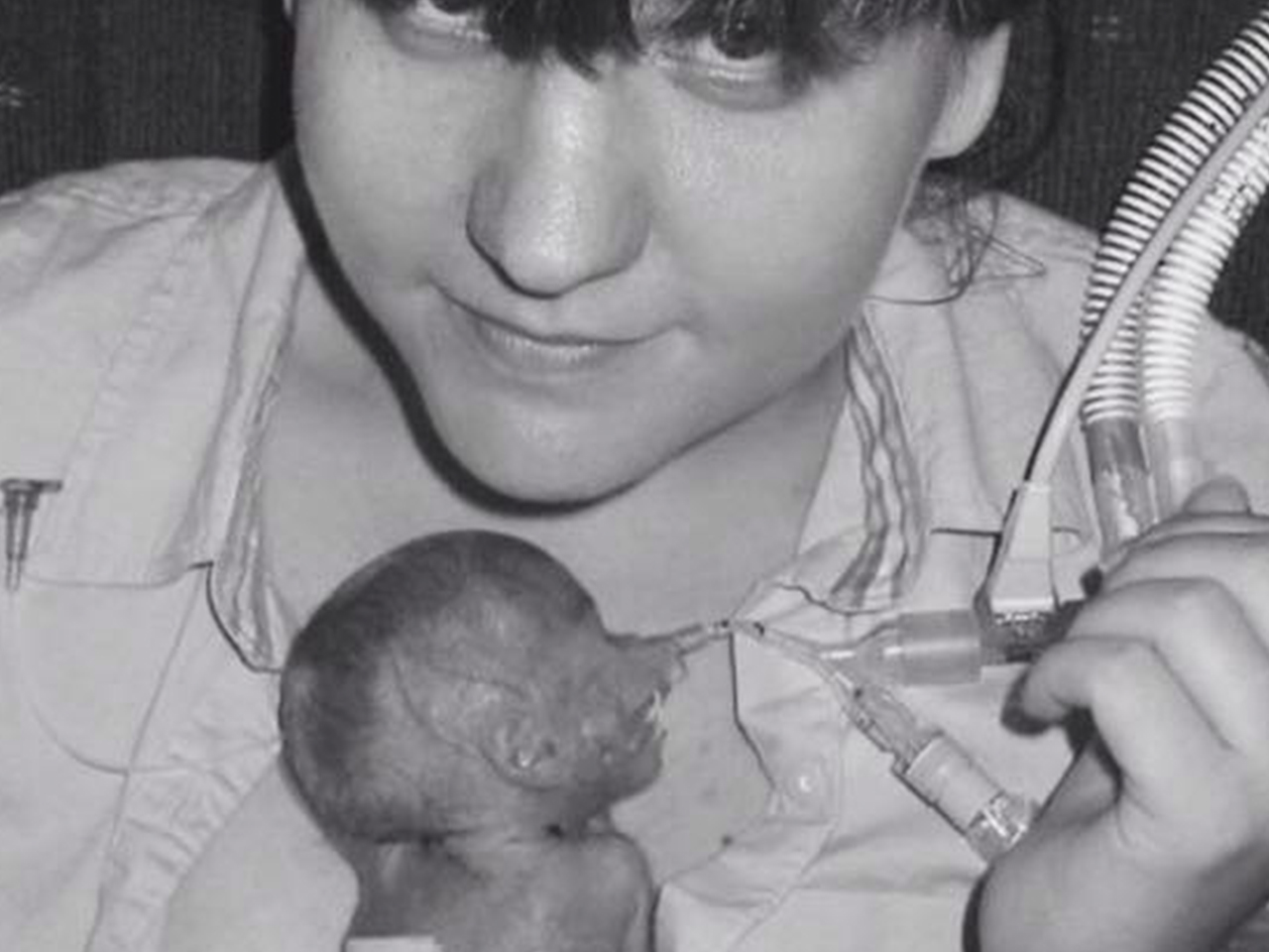 Kate Robson holds her firstborn, Maggie, when she was a preemie in the hospital
