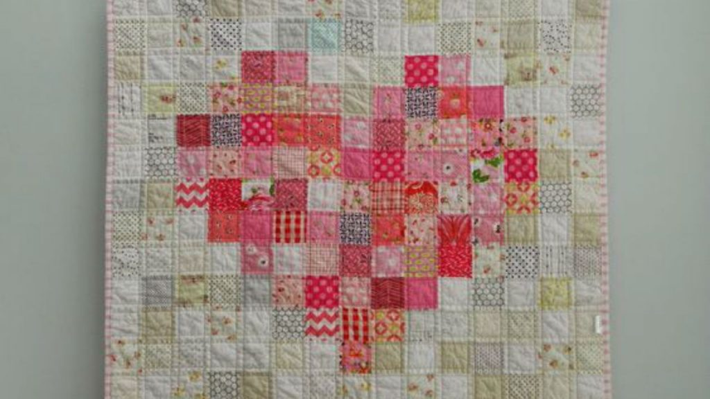 The beautiful Pink Love Baby Quilt by SotakHandmade.