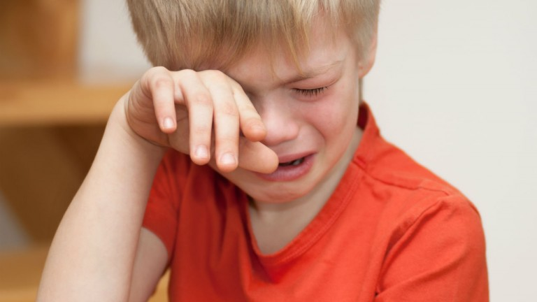 A young boy crying.