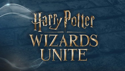 Golden logo for Harry Potter Wizards Unite on a dark background with magical wisps surrounding the text